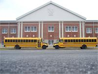 Two school buses parked in front of GAHS